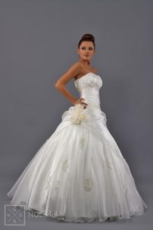 Geradliniges Bandeau-Brautkleid mit Rock aus luftigem Organza. Die zahlreichen Kräuselungen und die  glänzende Spitze geben das Gefühl für Weiblichkeit und Zärtlichkeit - 1705